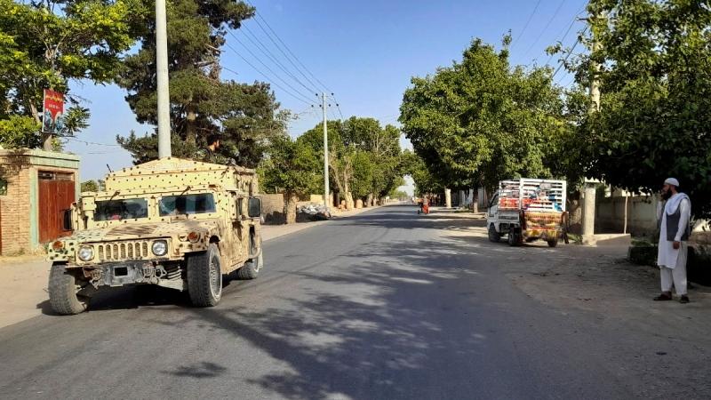 An Afghan army Humvee patrols in Kunduz city, north of Kabul, Afghanistan, on June 21, 2021. (Abdullah Sahil / AP)