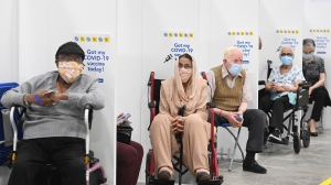 Elderly people wait 15 minutes after receiving their COVID-19 vaccine at the 'hockey hub' mass vaccination facility at the CAA Centre during the COVID-19 pandemic in Brampton, Ont., on Friday, June 4, 2021. THE CANADIAN PRESS/Nathan Denette