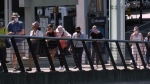 People line up for a COVID-19 vaccine outside the Vancouver Convention Centre on June 21, 2021.