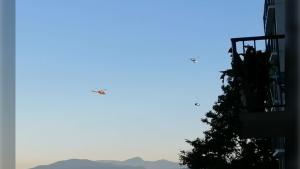 Two helicopters, one toting an SUV, are seen over Vancouver on Tuesday, June 22, 2021. (Submitted / Ian Bruce)