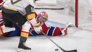 Vegas Golden Knights' Nicolas Roy scores against Montreal Canadiens goaltender Carey Price during overtime game 4 NHL Stanley Cup playoff hockey semifinal action in Montreal, Sunday, June 20, 2021. THE CANADIAN PRESS/Graham Hughes