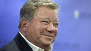 Actor William Shatner smiles while taking questions from reporters, Sunday, May 6, 2018, after delivering the commencement address at New England Institute of Technology graduation ceremonies, in Providence, R.I. Shatner was presented with an honorary doctor of humane letters degree during the event. (AP Photo/Steven Senne)