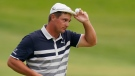 Bryson DeChambeau tips his cap after finishing on the 18th green during the final round of the U.S. Open Golf Championship, Sunday, June 20, 2021, at Torrey Pines Golf Course in San Diego. (AP Photo/Gregory Bull)