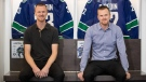 Former Vancouver Canucks' Henrik Sedin, left, and his twin brother Daniel Sedin, both of Sweden, pose for a photograph during a media availability ahead of a Wednesday ceremony where the NHL hockey team is scheduled to retire their numbers, in Vancouver, on Monday, Feb.10, 2020. (Darryl Dyck / THE CANADIAN PRESS)
