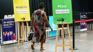 A woman arrives at a COVID-19 vaccination clinic in Montreal, on Monday, June 21, 2021. THE CANADIAN PRESS/Paul Chiasson