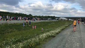 Crowds gather along the Trans-Canada Highway at Exit 7 near Thompson Station, N.S. and hold back traffic to protest travel restrictions imposed on New Brunswickers travelling to Nova Scotia. (TODD BATTIS / CTV ATLANTIC)
