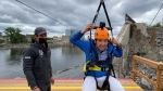 CTV's Tyler Fleming gets ready to ride the new zipline from Ottawa to Gatineau on Tuesday.