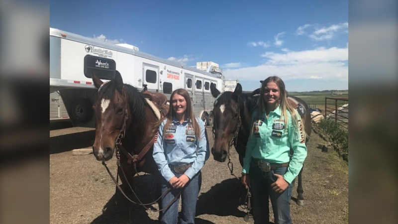 Kylie Whiteside and her horse Coy to the left (blue shirt) and her sister Bradi Whiteside in green with her horse Sis. Both sisters will be in Innisfail this weekend, trying to qualify for the Calgary Stampede.
