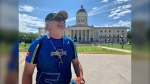 Larry Baillie visiting the Manitoba Legislature as one of his stops during a half-marathon honouring his dad who passed away from COVID-19. (Source: Scott Andersson/CTV News)