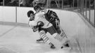 In this Dec. 12, 1977, file photo, Buffalo Sabres' Rene Robert (14), front, beats Vancouver Canucks' Don Lever (9) to the puck during first period of an NHL hockey game in Buffalo, N.Y. (AP Photo/File)