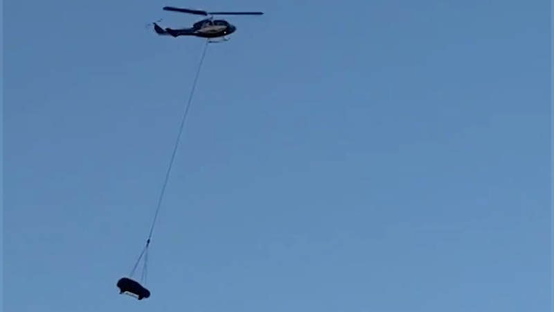 Helicopter hoists SUV in mid-air for TV ad