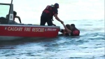 Calgary Fire Water Rescue crew pulled two people from the Bow Tuesday after their raft flipped over