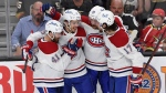 The Montreal Canadiens celebrate a goal by Montreal Canadiens center Jesperi Kotkaniemi, second left, during the first period in Game 5 of an NHL hockey Stanley Cup semifinal playoff series against the Vegas Golden Knights Tuesday, June 22, 2021, in Las Vegas. (AP Photo/David Becker)