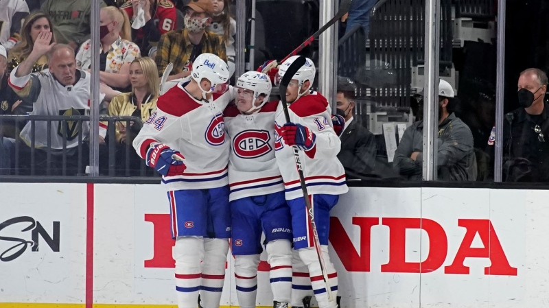 Montreal Canadiens right wing Cole Caufield, center, celebrates his goal during the second period in Game 5 of an NHL hockey Stanley Cup semifinal playoff series against the Vegas Golden Knights Tuesday, June 22, 2021, in Las Vegas. (AP Photo/John Locher)