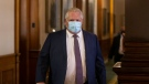 Ontario Premier Doug Ford walks into the Legislative chamber at Queens Park, in Toronto, on Monday June 14, 2021. THE CANADIAN PRESS/Chris Young