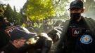 Police forcibly remove advocates and protesters during an eviction process at a homeless encampment in Toronto on Tuesday, June 22, 2021. THE CANADIAN PRESS/Chris Young