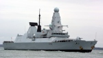 HMS Defender in Portsmouth, England, on March 20, 2020.  (Ben Mitchell / PA via AP)