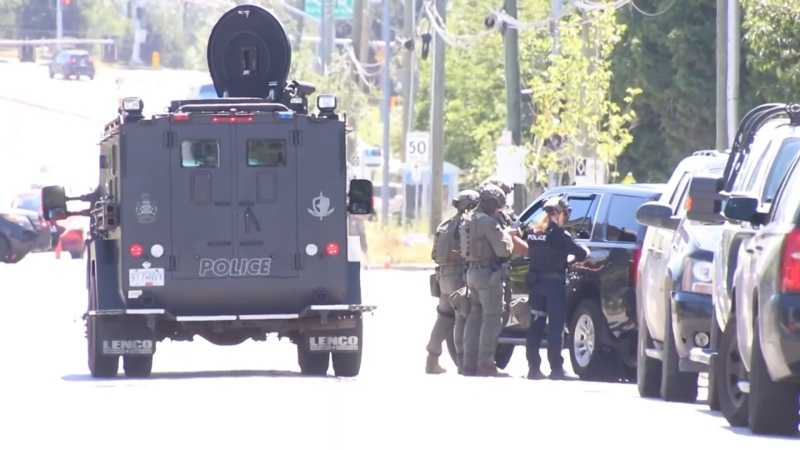 Mounties surrounded a home in Richmond, blocking off a townhouse complex for several hours on June 22, 2021.