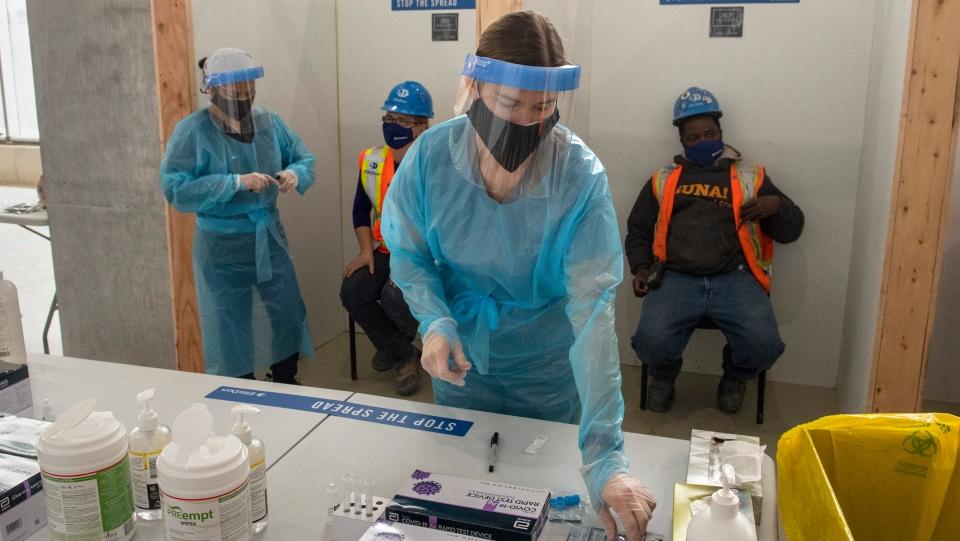 Nurses administer rapid COVID-19 tests