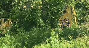 OPP investigate after a fatal accident involving a backhoe in Malahide Township, Ont. on Wednesday, June 23, 2021. (Brent Lale / CTV News)