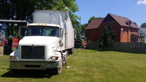 A tractor-trailer slammed into a Springfield, Ont. home on June 23, 2021. (@OPP_WR/Twitter)