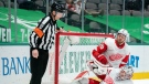 Detroit Red Wings goaltender Jonathan Bernier (45) and right wing Anthony Mantha (39) look to referee Chris Lee after the net broke free from its moorings on a goal by Dallas Stars' Andrew Cogliano during the second period of an NHL hockey game Thursday, Jan. 28, 2021, in Dallas. The goal was reviewed but confirmed. (AP Photo/Jeffrey McWhorter)