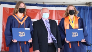 Avery Stronski, left, Tommy Douglas Collegiate principal Dave Fisher and Erika Stronski. (Submitted photo)