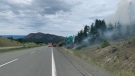 A small wildfire burned beside the Coquihalla Highway on June 23, 2021. (BC Transportation/Twitter)