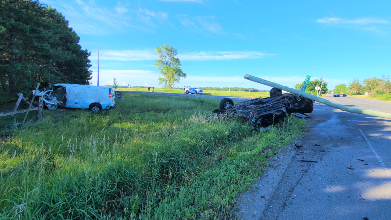 A white work van and black pickup truck were involved in a serious collision in Caledon, Ont. on Wed. June 23, 2021, that sent three to hospital. (OPP)