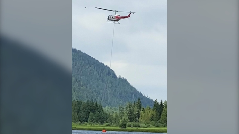 Helicopters spent the day scooping water from an area near Sunshine Valley and dumping it on the blaze, which is not threatening any structures. (CTV)