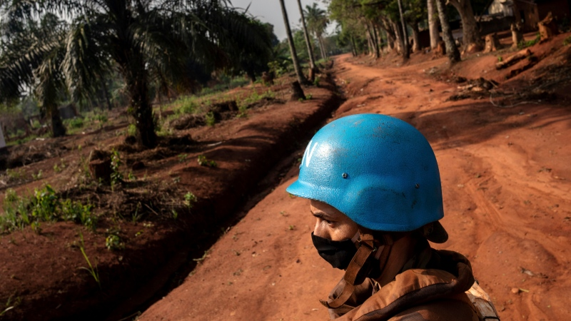Moroccan UN peacekeepers patrol Bangassou, Central African Republic, Sunday Feb. 14, 2021. An estimated 240,000 people have been displaced in the country since mid-December, according to UN relief workers, when rebels calling themselves the Coalition of Patriots for Change launched attacks, causing a humanitarian crisis in the already unstable nation. (AP Photo/Adrienne Surprenant)
