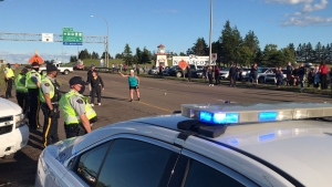 The RCMP moved in to end the illegal blockade that began Tuesday afternoon as a protest to travel restrictions imposed by Nova Scotia on travellers coming from New Brunswick. (PAUL CREELMAN / CTV ATLANTIC)