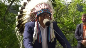Chief Aaron Young speaks at a press conference on Wednesday as the Alberta government announced $8 million to search for remains of children that residential school survivors know are buried at the 25 former residential schools the province housed.