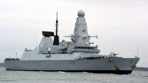 This March 20, 2020 file photo shows HMS Defender in Portsmouth, England. The Russian military says its warship has fired warning shots and a warplane dropped bombs to force the British destroyer from Russia's waters near Crimea in the Black Sea. The incident on Wednesday June 23, 2021, marks the first time since the Cold War era when Moscow used live ammunition to deter a NATO warship, reflecting soaring Russia-West tensions. (Ben Mitchell/PA via AP, File)
