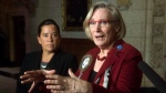 Then-Minister of Justice and Attorney General of Canada Jody Wilson-Raybould, left, looks on as Minister of Indigenous and Northern Affairs Carolyn Bennett speaks about the Canadian Human Rights Tribunal regarding discrimination against First Nations children in care during a news conference on Parliament Hill in Ottawa, Tuesday, January 26, 2016. THE CANADIAN PRESS/Adrian Wyld