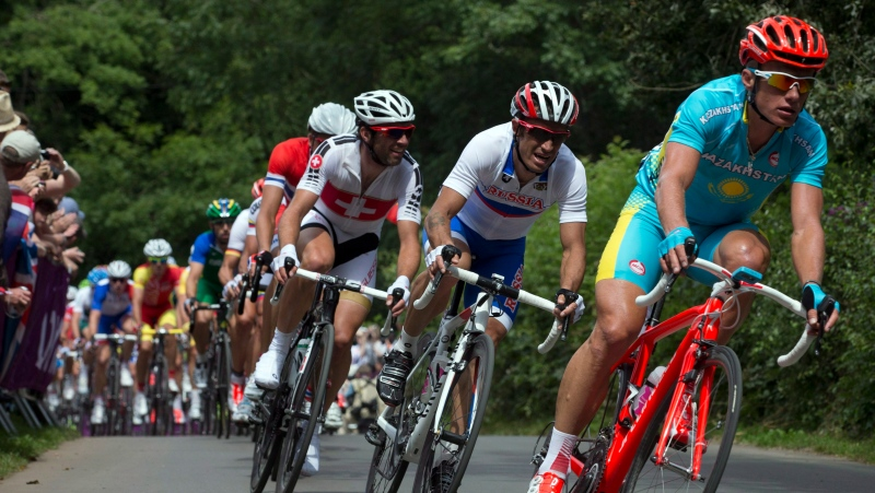 Alexandre Vinokourov (right) of Kazakstan dives into a corner on Box Hill on his way to winning the Men's Olympic Cyclirng Road Race in London on Saturday July 28, 2012. THE CANADIAN PRESS/Frank Gunn