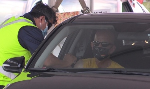 A worker takes advantage of the drive-thru vaccine clinic held at the Cargill Plant in London, Ont. on Thursday, June 24, 2021. (Daryl Newcombe / CTV London)