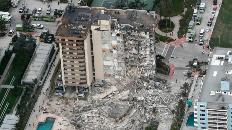 This aerial photo shows part of the 12-story oceanfront Champlain Towers South Condo that collapsed early Thursday, June 24, 2021 in Surfside, Fla. (Amy Beth Bennett/South Florida Sun-Sentinel via AP)
