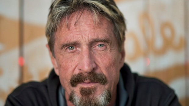 Antivirus pioneer John McAfee poses for a photograph in Montreal, Friday, August 24, 2013.THE CANADIAN PRESS/Graham Hughes