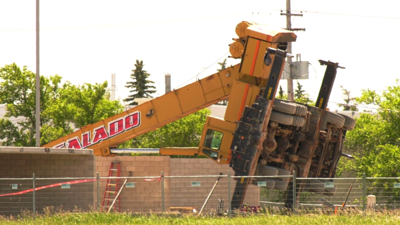 A crane is pictured here on its side at a construction site along McPhillips Street near Storie Road on June 24, 2021. (Source Glenn Pismenny/ CTV News Winnipeg)