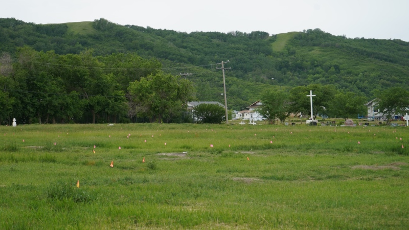 Orange flags mark burial sites in a cemetery near the grounds of the former Marieval Indian Residential School on Cowessess First Nation. (Marc Smith/CTV News)
