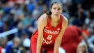 """In this July 29, 2016, file photo, Canada's Kim Gaucher watches during a break in the second half of a women's exhibition basketball game in Bridgeport, Conn. Gaucher say she is being """"forced to decide between being a breastfeeding mom or an Olympic athlete."""" COVID-19 rules prevent her from bringing her daughter, Sophie, who was born in March, to the Tokyo Olympics next month. She says Olympic organizers have said """"no friends, no family, no exceptions."""" The 37-year-old Gaucher is looking into options, such as shipping milk, but has run into complications. (AP Photo/Jessica Hill, File)"""