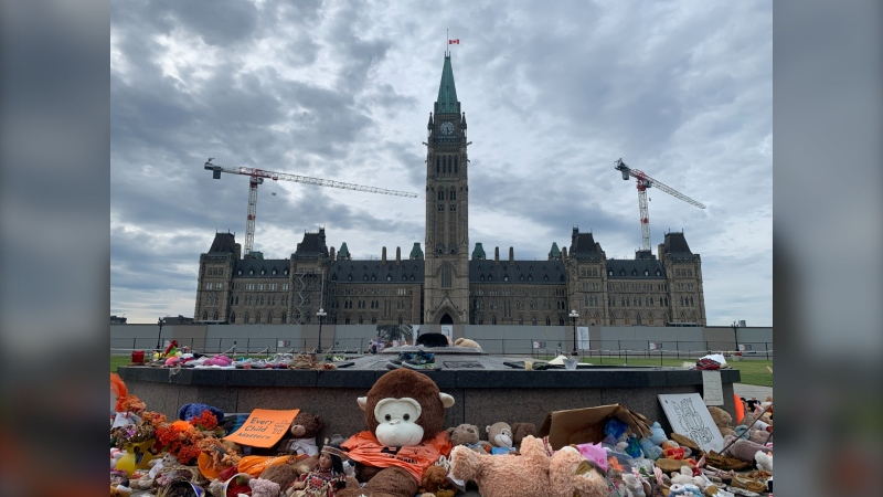 A memorial of stuffed animals, shoes and other items at the Centennial Flame on Parliament Hill on Thursday. (Chris Black/CTV News Ottawa)