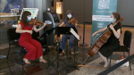 A trio with the Vancouver Symphony Orchestra performs at a COVID-19 vaccine clinic.