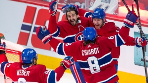 Montreal Canadiens left wing Artturi Lehkonen (62) celebrates with teammates after scoring the winning goal against the Vegas Golden Knights during overtime NHL Stanley Cup playoff hockey semifinal action Thursday, June 24, 2021 in Montreal. THE CANADIAN PRESS/Ryan Remiorz