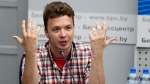 Belarusian dissident journalist Raman Pratasevich gestures while speaking at a news conference at the National Press Center of Ministry of Foreign Affairs in Minsk, Belarus, Monday, June 14, 2021. (Ramil Nasibulin/BelTA pool photo via AP)