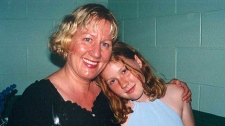 Sara Shannon is seen hugging her daughter Sabrina Shannon, 13, who died from an allergic reaction to milk at her Ontario school in 2003.
