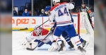 Montreal Canadiens goaltender Jake Allen (34) makes a pad save as Toronto Maple Leafs forward Zach Hyman (11) and Canadiens defenceman Joel Edmundson (44) battles for the loose puck during third period NHL hockey action in Toronto on Wednesday, April 7, 2021. THE CANADIAN PRESS/Nathan Denette