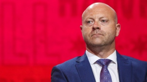 In this July 26, 2019, file photo, Chicago Blackhawks senior vice president and general manager Stan Bowman attends the NHL hockey team's convention in Chicago. (AP Photo/Amr Alfiky, File)