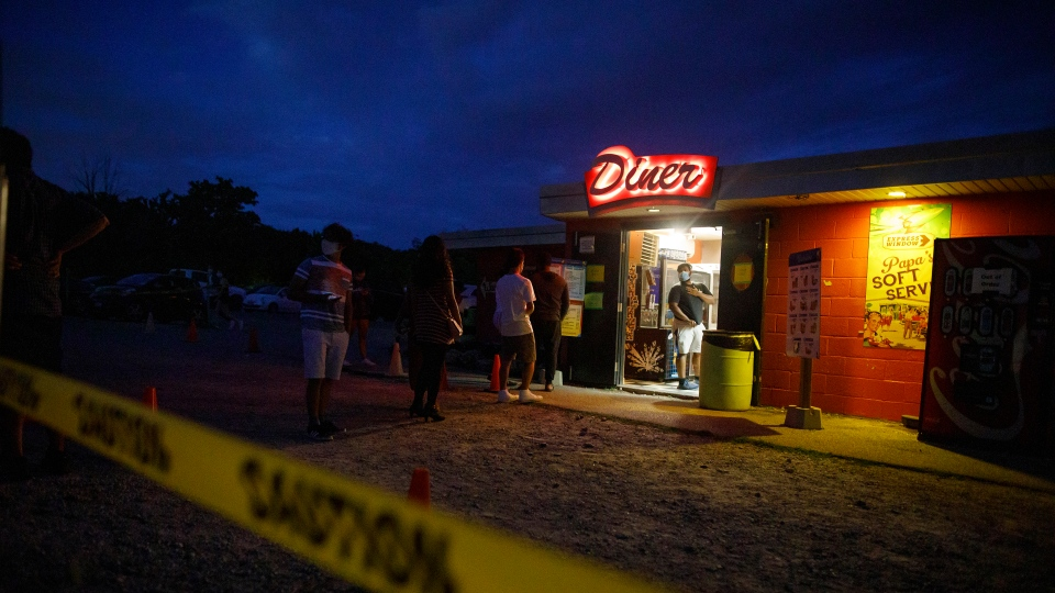 Moviegoers get popcorn and snacks at the 5 Drive-In Theatre in Oakville, Ont., during the premier of Jay Baruchel's movie Random Acts of Violence, Wednesday, July 29, 2020. THE CANADIAN PRESS/Cole Burston